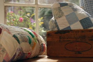 Quilts by window
